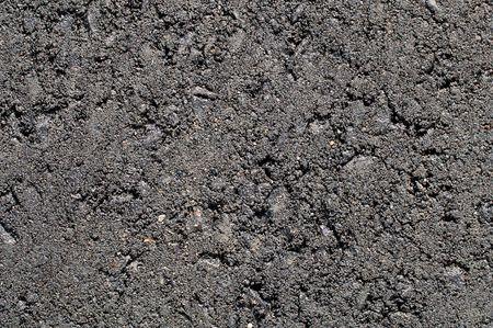 Brand new asphalt paving of a driveway. Macro. 12MP camera.
