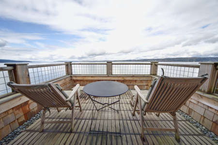 A zen-like balcony at an inn on Whidbey Island, Washington, USA. HDR technique. Фото со стока
