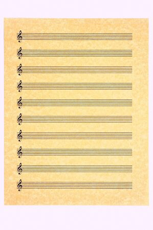 A blank music sheet, treble clef, on parchment paper ready for your composition. Isolated.