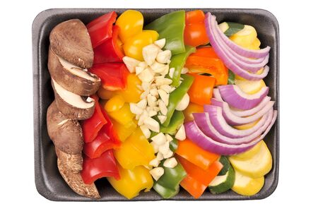 Convenient store prepared stir fry vegetables on a tray. Isolated.