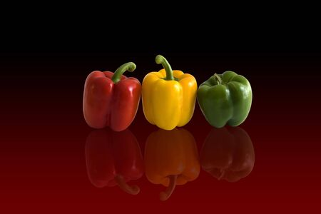 Three peppers in arow on red background Imagens