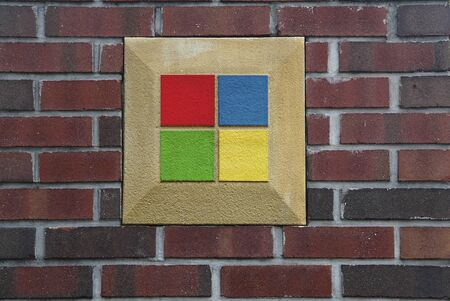 Brick wall with red, yellow, blue and green inserts