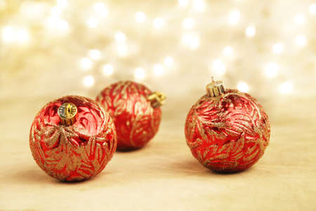 red and gold christmas ornaments on gold background with white lights stock photo 14988108 - White And Gold Christmas Ornaments