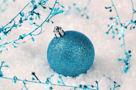 Blue Christmas ornament and garland Stock Photo