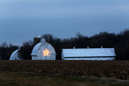 farmstead: An old white barn with Christmas star in Illinois Editorial