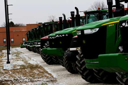 deere: A row of John Deere tractors