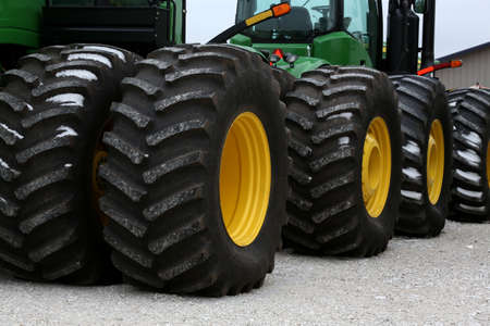 John Deere tractor tires all in a row Stock Photo - 17051380