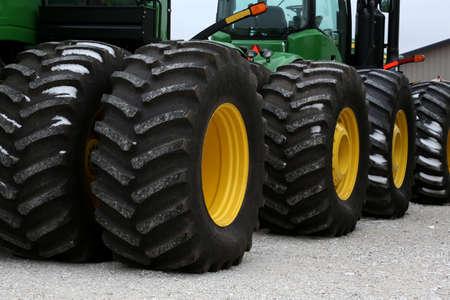 deere: John Deere tractor tires all in a row Editorial
