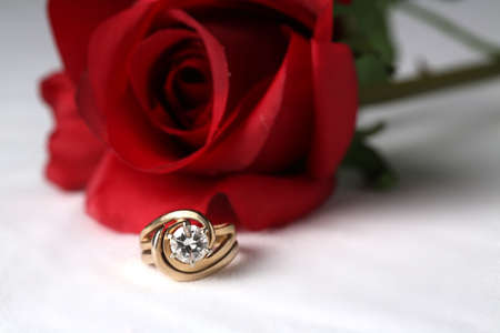 Womans wedding ring with red rose Stock Photo