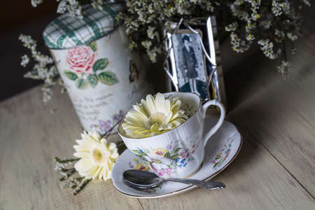 Antique teacup, flowers and photograph photo