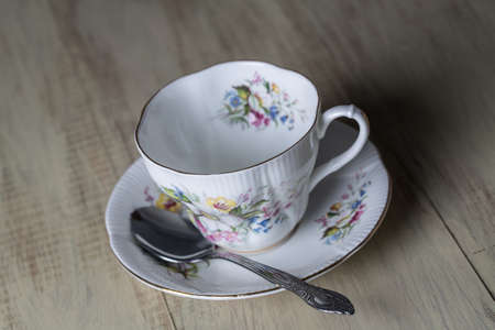 Antique teacup and spoon photo