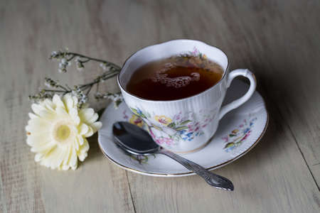 Antique teacup and flower photo