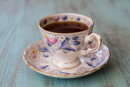 Cup of tea in antique bone china teacup