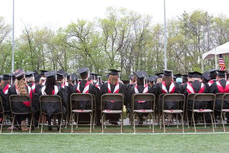 adulthood: college graduates at ceremony Stock Photo