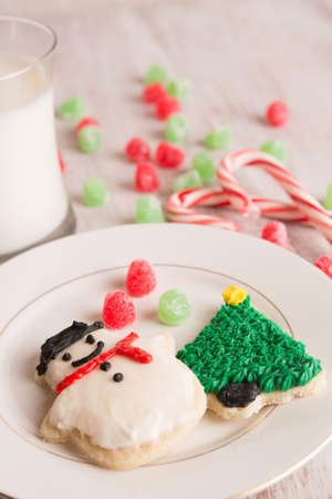 home made Christmas cookies with gumdrops, candy canes and milk photo