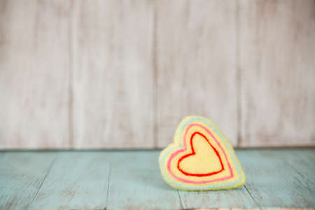 Yellow Valentines Day heart on vintage wood backdrop Фото со стока - 25999646