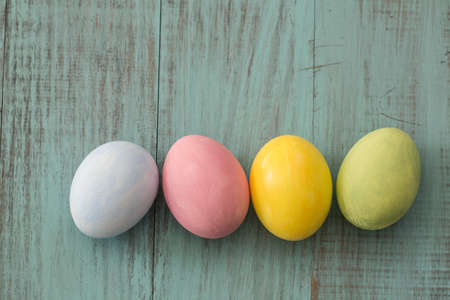 Four pastel painted Easter eggs photo