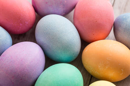 close up of colored Easter eggs on wood background photo