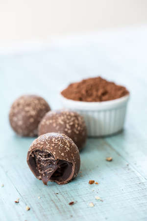 Chocolate truffle candies with crumbs with cocoa powder photo