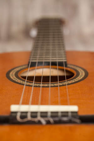 Close up macro of wood acoustic guitar for playing music photo