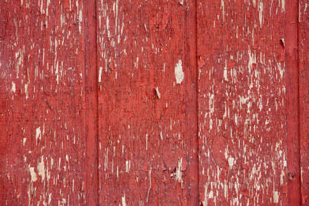 chipped: Red chipped paint barn wood wall background texture Stock Photo