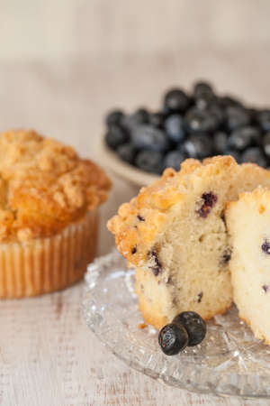 Blueberry muffin breakfast scene with bowl of blueberries in the background photo