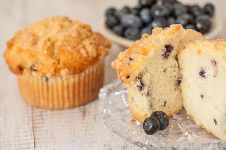 baked treat: Blueberry muffin breakfast scene with bowl of blueberries in the background
