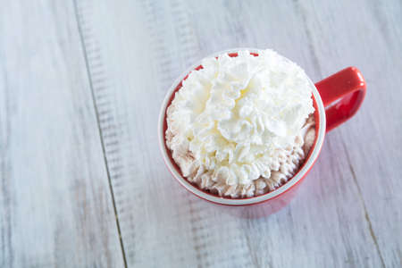Cold weather winter drink hot chocolate with whipped cream Фото со стока