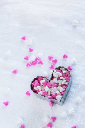 cutter: Valentines Day mini heart sweet candy in cookie cutter Stock Photo