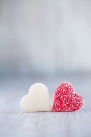 valentine's day: Red and white Valentines Day gummy candy hearts next to each other vertical