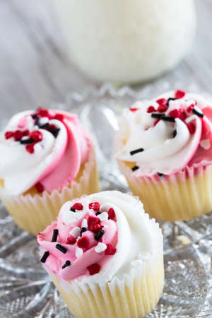 Valentines Day cupcakes with heart sprinkles and icing Stock Photo