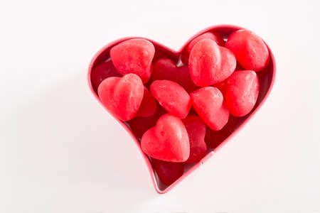 cookie cutter: Valentines Day red chewy candy in pink cookie cutter Stock Photo