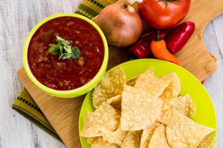 tortilla chips: Tortilla chips with salsa and onion, tomato, peppers snack food Stock Photo