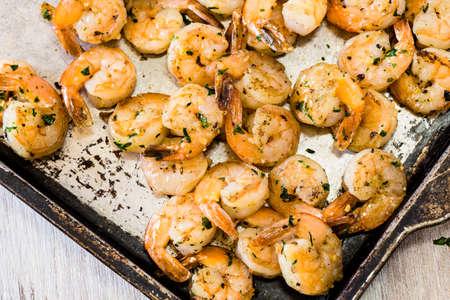 lemon wedge: Shrimp appetizer or dinner on metal pan from above Stock Photo