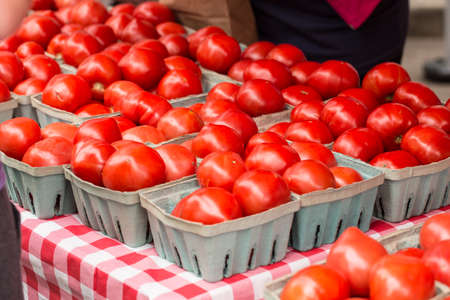 Delicious tomatoes in baskets on a table at the farmers market in Knoxville Tennessee