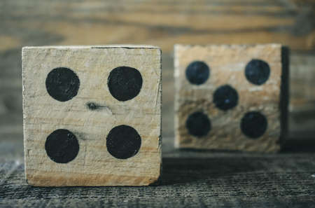 Wooden Dice on wood table
