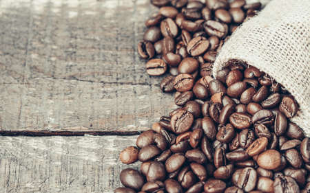 Coffee beans on wooden Close Up