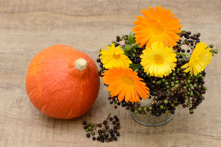 bunch of flowers and pumpkin photo