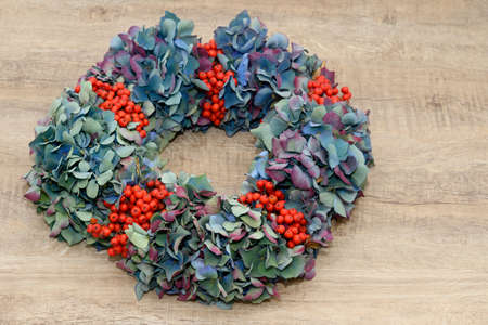 peasantry: autumn  wreath lying on wood