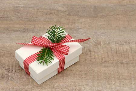 enveloped: Present lying on wood