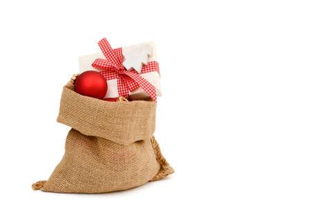 enveloped: Xmas present in santa bag Stock Photo