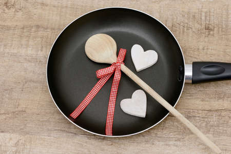 frying pan: wooden spoon and frying pan