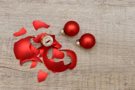 shiny christmas baubles: broken xmas ball on wood Stock Photo