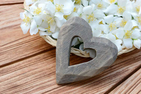 Heart and flower basket on wooden table