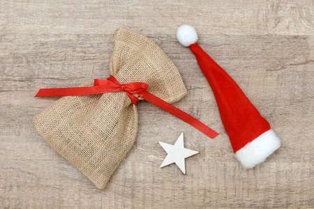sac: santa sac and Christmas hat lying on wood