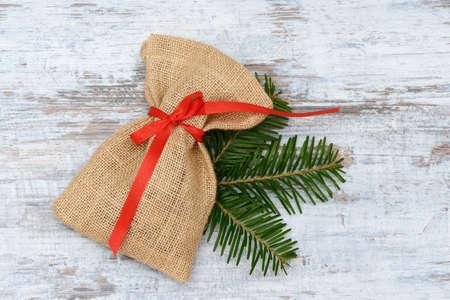 sackful: santa bag lying on wood