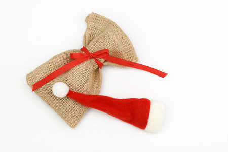sac: santa sac and Christmas hat isolated on white