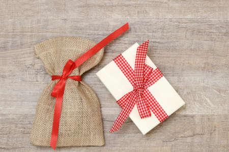 sac: santa sac and xmas present lying on wood Stock Photo