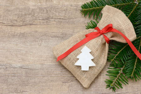 sac: santa sac lying on wood with fir branch