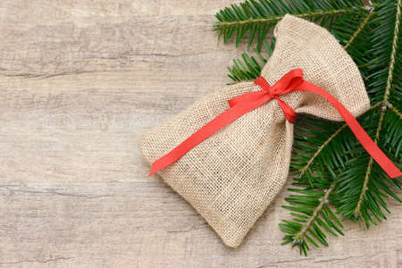 sac: santa sac  lying on wood